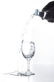 Water pouring in glass isolated. On white Royalty Free Stock Photo