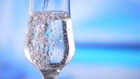 Water pouring into glass slow motion fresh natural cool with bubbles. This type of clips could be used to highlight health, purity, nature and coal liquid stock footage