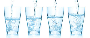 Water pouring into glasses. Set of different pictu Stock Images