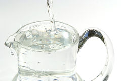 Water pouring in jug Royalty Free Stock Photos