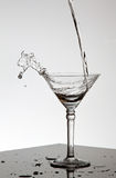 Water pouring in Martini glass Royalty Free Stock Photo