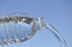 Water pouring out of Plastic Bottle Royalty Free Stock Images