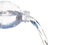 Water pouring out of Plastic Bottle Stock Photo