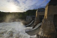 Water pouring over dam stock images