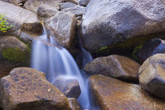 Water Pouring Over Rocks Stock Image