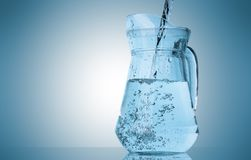 Water pouring into pitcher Royalty Free Stock Photography
