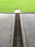 Water Pouring into Street Storm Drain Royalty Free Stock Photos