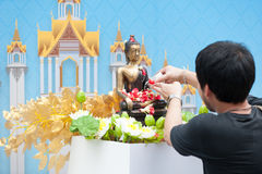 Water pouring to Buddha statue in Songkran festival tradition of. Bangkok,Thailand 2017 Stock Photography