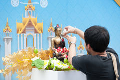 Water pouring to Buddha statue in Songkran festival tradition of. Bangkok,Thailand 2017 Stock Photos