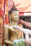 Water pouring to Buddha statue. In Songkran festival tradition of Thailand Stock Images