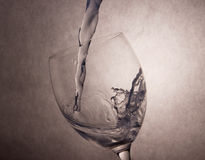 Water Pouring to Vine Glass Stock Images