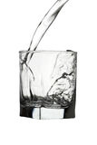 Water pouring into transparent glass isolated on white. Water pouring into transparent glass isolated Stock Photos