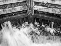 Water Pouring Through Wooden Lock Stock Photos