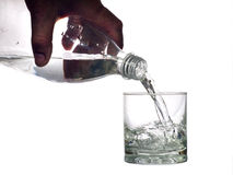 Water pours into a glass Stock Images