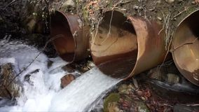 Water pours from a pipe stock footage
