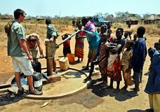Water & Poverty, Niassa, Mozambique. Safari operators building a camp in Niassa Province, Northern Mozambique collect potable water from a recently sunk borehole Royalty Free Stock Photo