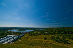 Water power plant. In Zydowo, Poland. Gigantic water pipes descending to a lake Stock Images