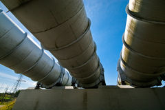 Water power plant pipes. Gigantic water pipes of a power plant seen from below Royalty Free Stock Photo