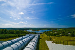 Water power plant in Zydowo Poland. Three giant pipes going downhill to a lake, water power plant in Zydowo Poland. Eco green energy, industry Royalty Free Stock Photos