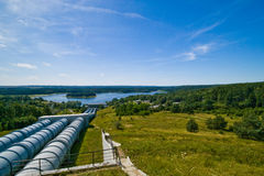 Water power plant in Zydowo Poland. Three giant pipes going downhill to a lake, water power plant in Zydowo Poland. Eco green energy, industry Stock Image