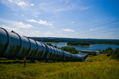 Water power plant in Zydowo Poland. Three giant pipes going downhill to a lake, water power plant in Zydowo Poland. Eco green energy, industry Royalty Free Stock Photo