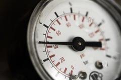 Water pressure gauge. A close-up water pressure gauge Stock Images