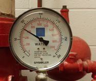 Pressure Gauge. Gauge on a pressurized water main system Royalty Free Stock Photography