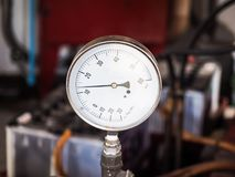Water pressure meter. While turning on the pump Stock Photo