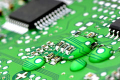 Water on the printed circuit. Stock Image
