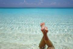 Water procedure. Women are relaxinhg in the  warm water of the Indian Ocean Stock Image