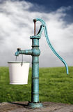 Water pump. Photo of a old green water pump on a field royalty free stock photos