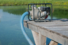 Water pump. Updated water from a lake stock photos