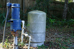 Water Pump. Electric water with tank in back yard royalty free stock photography
