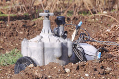 Water pump. A small industrial water pump used for irrigating farm crops stock photo