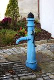 Water pump. Ancient blue hand water pump royalty free stock photos