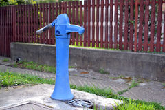Water pump. Blue manual water well pump Royalty Free Stock Photography