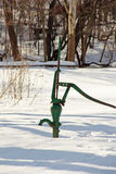 Water pump covered in snow Stock Images