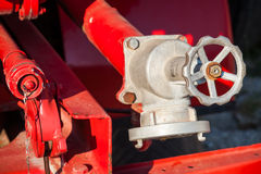 Water pump fragment with hydrant. Firefighters Equipment of fire truck Royalty Free Stock Photography
