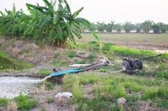 Water pump in grow tree crops garden Stock Photography