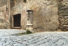 Water Pump on the Paved Streets of Rome Italy stock images