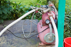 Water pump with pipes. Stock Images