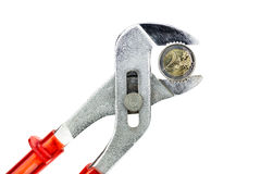 Water pump pliers holding two euro coin on white background Royalty Free Stock Photos