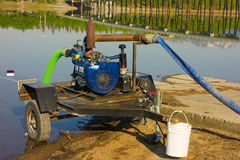A water pump beside the tagish river in the yukon territories Royalty Free Stock Photos