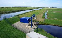 A water pumping station in the Netherlands. A water pumping station in the Reeuwijkse Plassen nature area, South Holland province, the Netherlands Royalty Free Stock Photo