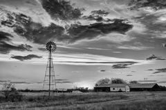 Windmill at sunset. Monochrome Royalty Free Stock Photos