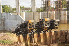 Water pumps at dam construction site. Royalty Free Stock Photo