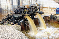 Water pumps are pumping at the dam  site. Royalty Free Stock Photos
