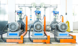 Water pumps. Several water pumps with large electric motors Stock Photography