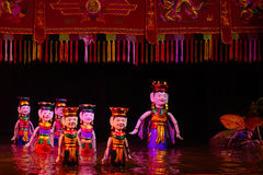 Water puppet show in Hanoi Vietnam. Dancing and happy water puppet Royalty Free Stock Images