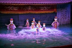 Water puppet show in Vietnam under purple lights Royalty Free Stock Images
